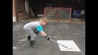 Hockey kid misses goal and shatters window - Video