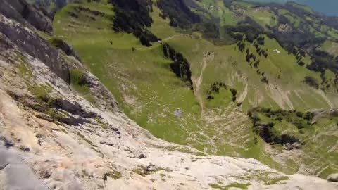 POV wingsuit proximity flight in Switzerland