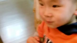 Adorable baby using chopsticks