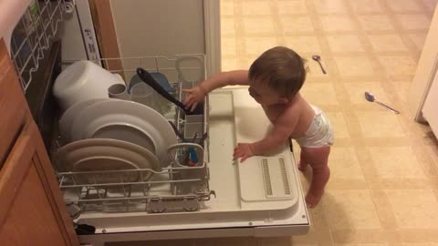 "Baby ""helps"" mommy with the dishes"