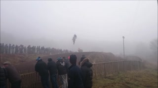 Dirt bike rider crashes into fence following huge jump - Video
