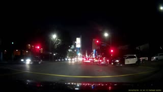 Driver Runs Red Light in Front of LAPD - Video