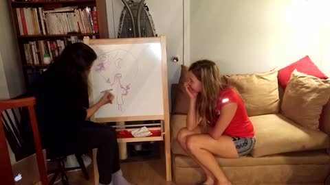 Couple Use Pictionary For Pregnancy Announcement