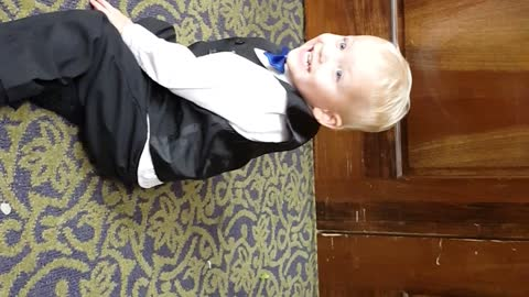 Toddler rocks out in a tux
