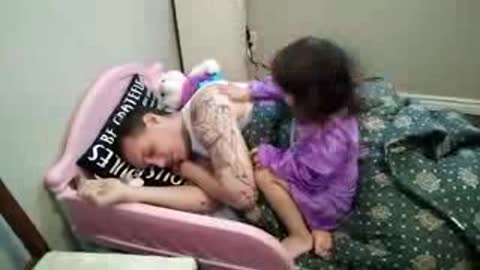 Evil little girl puts daddy to sleep her way!