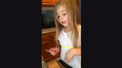Toddler illustrates candy-making process