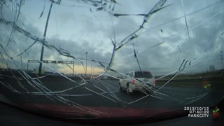 Flying Object Smashes Car Windshield - Video
