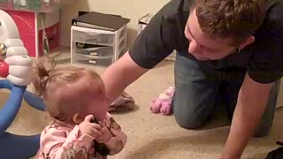 Baby absolutely terrified of dad's new haircut - Video