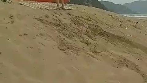 Guys back flipping in sand face plant