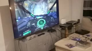 Guy sleeps while friend plays with vr headset  - Video