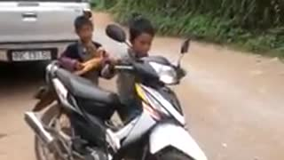 Vietnamese children driving motorcycles  - Video