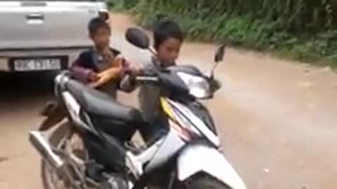 Vietnamese children driving motorcycles