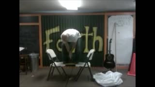 Reckless Man Saws Wood While STANDING On Two Chairs - Video