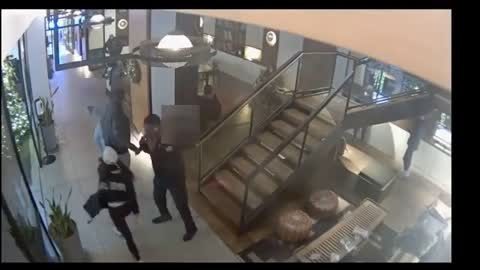 NYPD releases video of woman attacking Keyon Harrold Jr.