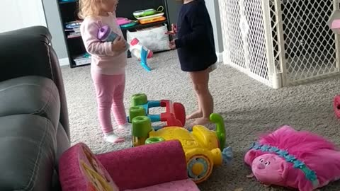 Toddler can't believe what he catches his twin sister doing