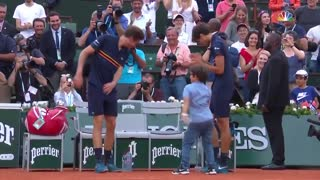 Mahut son dancing with him after victory