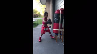 4-year-old boxing prodigy freestyles on heavy bag - Video