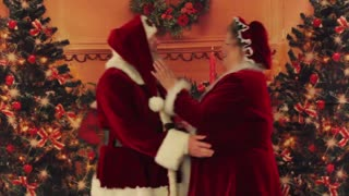 Santa and Mrs. Claus dance the christmas carlton