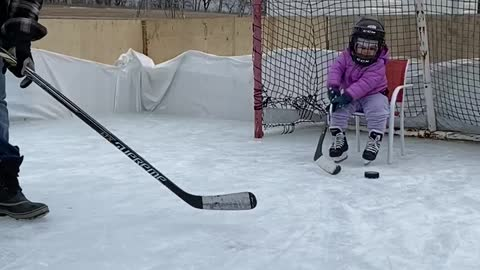 Frustrated goalie throws her stick when dad scores on her