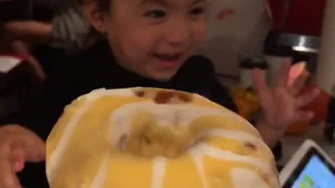 Toddler tries the real Mango Bango doughnut