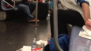 A man on a subway surrounded by his things on subway - Video