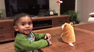 Baby has conversation with repeating hamster toy - Video