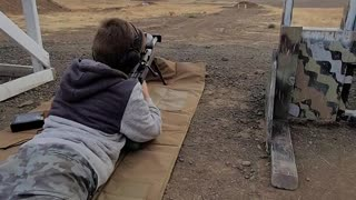 Kid hits 1200 yds with 1st shot with .50 bmg