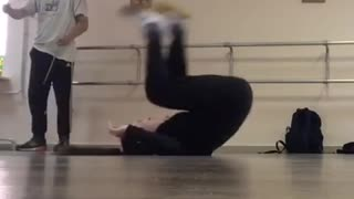 Girl does handstand and falls on her head