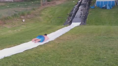 Big Man Is Unstoppable And Goes Flying Off The Slip 'N Slide