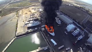 Yacht On Fire In Shipyard - Aerial View From Drone