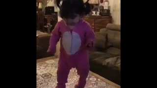 Egyptian baby girl dancing with the cat in a way