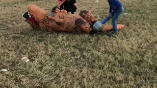 Kids Take Down T-Rex at Download Festival - Video
