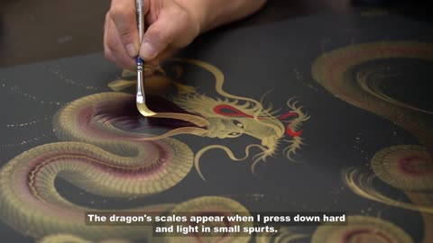 The artist painting a dragon's full body with one single stroke