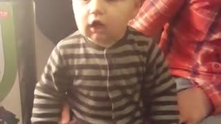 Baby on vibrating workout machine makes comical noises - Video