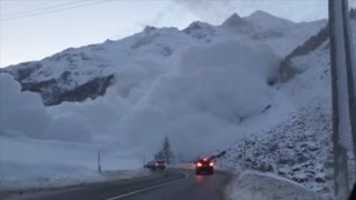 Swiss Drivers Scramble to Avoid Avalanche - Video