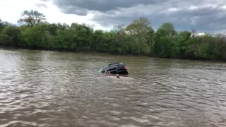 Woman Rescued from Sinking Car