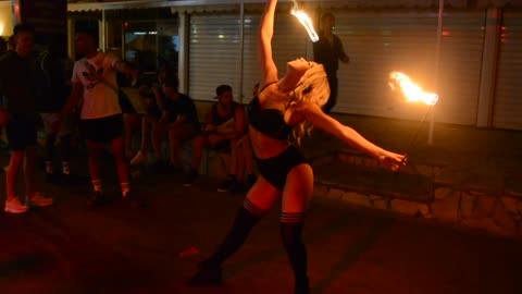 Beautiful woman performs impressive fire act