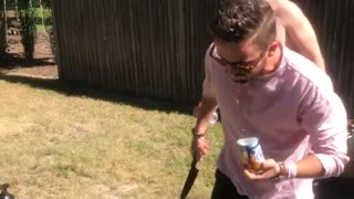 Guy pink shirt opens beer with knife - Video
