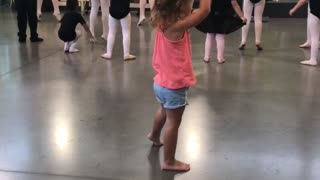 Little girl tries to keep up with ballerina class