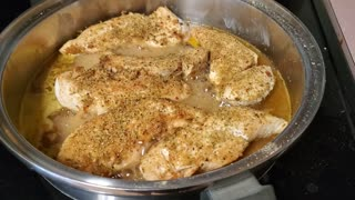 Cooking some chicken for chicken and rice tonight.