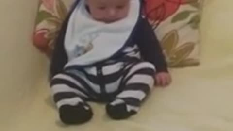 Adorable baby discovers feet for first time