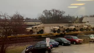 A Multitude of Military Vehicles Heading into Chicago