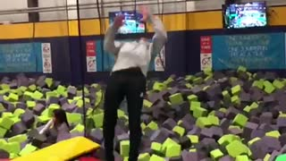 Guy does backflip off off trampoline and lands in foam pit