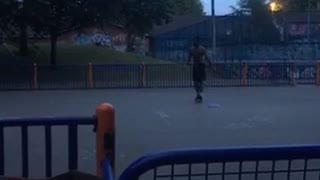 Guy dunks on basketball net lets go and falls on back - Video