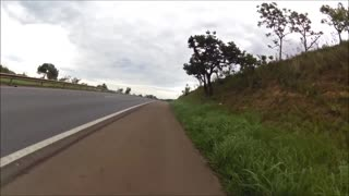 Cyclist Doing 60 mph Behind Truck in Brazil - Video