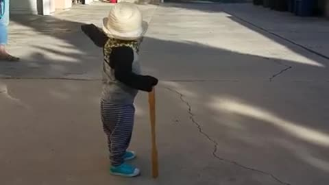 "This awesome toddler is a complete gentleman with his hat and ""cane"" and it's adorable"