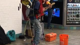 Old man playing colorful drums instrument combination