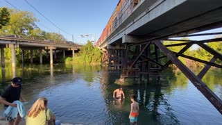 San Marcos River with Train passing