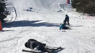 Skier in black and other in blue fall down slope - Video