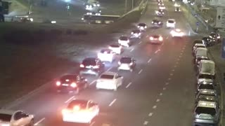 Driver Crashes Into Barrier And Tumbles Off Overpass
